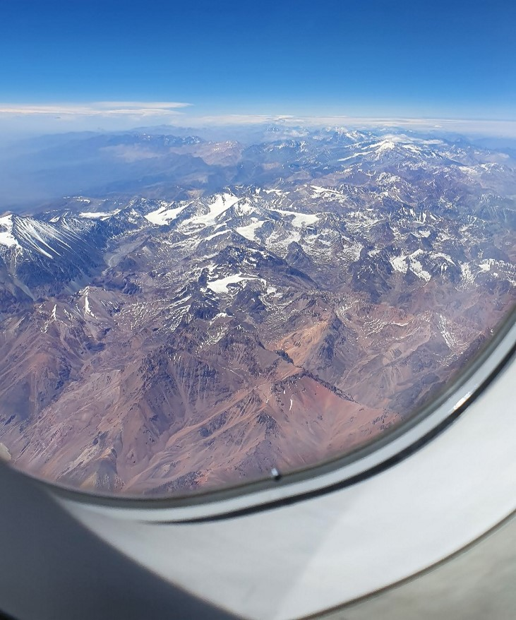 Snow capped peaks of the Andes from the airplane window on descent