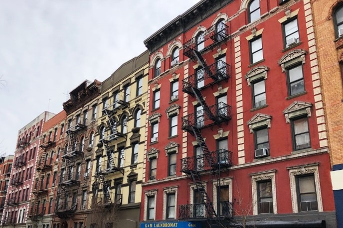The apartment windows and exposed fire escapes of NYC's housing